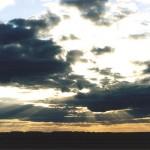 Закат за тучами